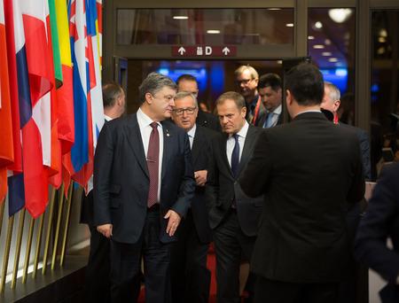 donald: BRUSSELS, BELGIUM - Mar 17, 2016: President of Ukraine Petro Poroshenko, President of European Council Donald Tusk and European Commission President Jean-Claude Juncker during a meeting in Brussels Editorial