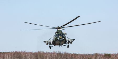 reg: KIEV REG, UKRAINE - Mar 26, 2016: Armed forces of Ukraine. Ukrainian military helicopter during the execution of the training combat mission