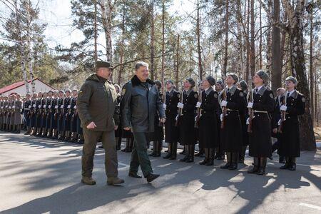 reg: KIEV REG, UKRAINE - Mar 26, 2016: President of Ukraine Petro Poroshenko during a visit to the training center of the National Guard of Ukraine in Novi Petrivtsi