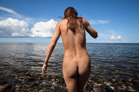 nude nature: Beauty Girl Outdoors enjoying nature. Healthy lifestyle concept. Young nude woman goes to sea