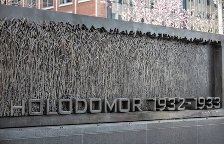 honors: WASHINGTON D.C., USA - Mar 31, 2016: The Holodomor Memorial honors the millions of victims of the 1932-1933 genocidal famine in Ukraine, ordered by Soviet dictator Joseph Stalin