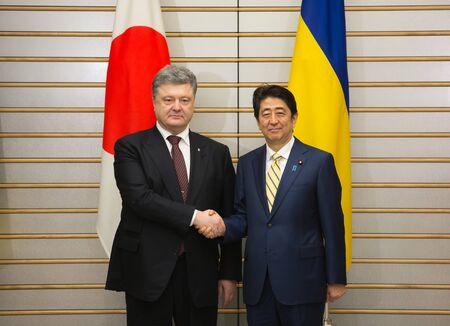 abe: TOKYO, JAPAN - Apr 06, 2016: Meeting between President of Ukraine Petro Poroshenko and Prime Minister of Japan Shinzo Abe, in Tokyo