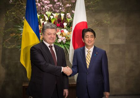 abe: TOKYO, JAPAN - Apr 06, 2016: President of Ukraine Petro Poroshenko during his meeting with Japanese Prime Minister Shinzo Abe in Tokyo