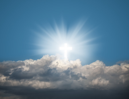 redemption: Sign of faith. Glowing holy cross in the blue  sky with white clouds