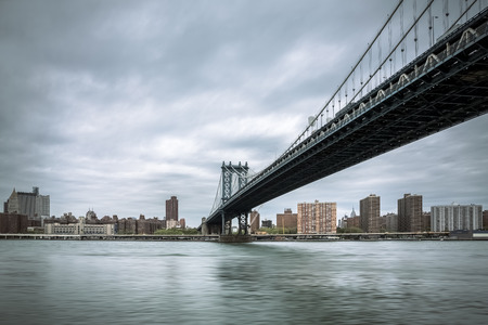 East River and the Manhattan Bridge on a cloudy day. New York, USA Stock Photo