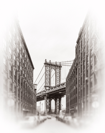 Manhattan Bridge and Empire State Building seen from Brooklyn, New York. Black and white image with a blurred foreground. Old photo stylization, film grain added. Sepia toned Stock Photo