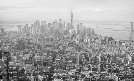 broadway tower: New York City and Brooklyn skyline. Black and white image of Manhattan panorama viewed from Empire State Buildig on a foggy day