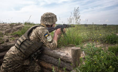 highly: ZHYTOMYR REG, UKRAINE - May 27, 2016: Soldiers of the Armed Forces of Ukraine at the military training area of the AFU highly mobile airborne troops