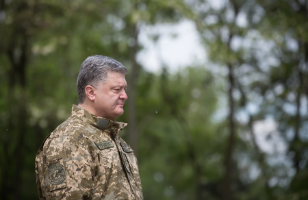 sniper training: ZHYTOMYR REG, UKRAINE - May 27, 2016: President, Supreme Commander-in-Chief of the Armed Forces of Ukraine Petro Poroshenko at the military training area of the AFU highly mobile airborne troops