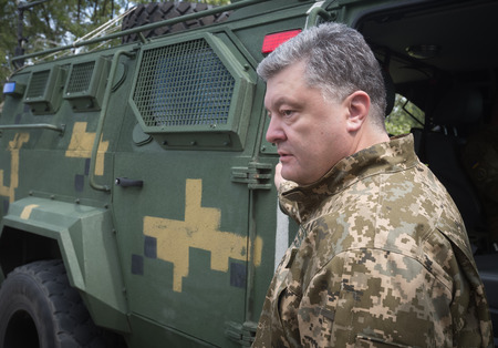 area of conflict: ZHYTOMYR REG, UKRAINE - May 27, 2016: President, Supreme Commander-in-Chief of the Armed Forces of Ukraine Petro Poroshenko at the military training area of the AFU highly mobile airborne troops