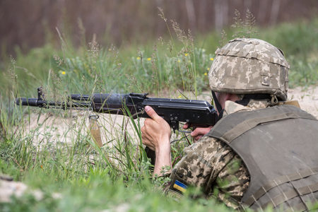 sniper training: ZHYTOMYR REG, UKRAINE - May 27, 2016: Soldiers of the Armed Forces of Ukraine at the military training area of the AFU highly mobile airborne troops