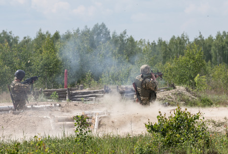 troops: ZHYTOMYR REG, UKRAINE - May 27, 2016: Soldiers of the Armed Forces of Ukraine at the military training area of the AFU highly mobile airborne troops