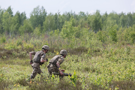 reg: ZHYTOMYR REG, UKRAINE - May 27, 2016: Soldiers of the Armed Forces of Ukraine at the military training area of the AFU highly mobile airborne troops