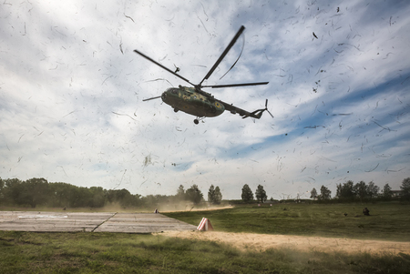 area of conflict: ZHYTOMYR REG, UKRAINE - May 27, 2016: Mi-8 helicopter with the President of Ukraine aboard arived to military training area of the AFU highly mobile airborne troops in Zhytomyr region