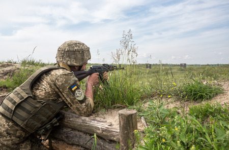 area of conflict: ZHYTOMYR REG, UKRAINE - May 27, 2016: Soldiers of the Armed Forces of Ukraine at the military training area of the AFU highly mobile airborne troops