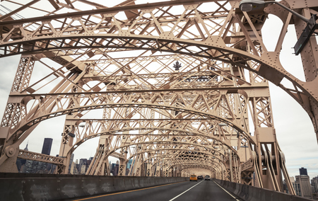 queensboro bridge: NEW YORK, USA - Apr 27, 2016: Ed Koch Queensboro Bridge from Manhattan to Queens. Cars on Queensboro Bridge and New York City Manhattan on background
