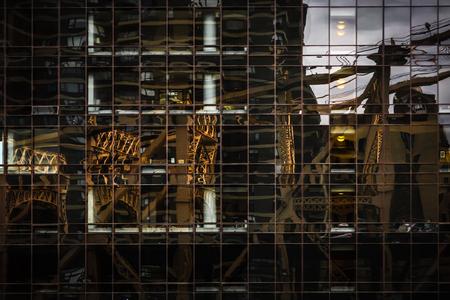 queensboro bridge: Ed Koch Queensboro Bridge reflection in the glass surface of a modern building in Manhattan