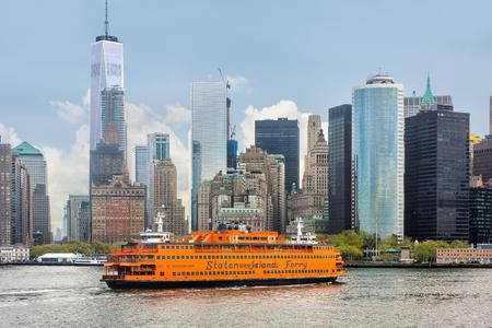 staten: NEW YORK, USA - Apr 28, 2016: Staten Island Ferry on the New York Harbor against of Lower Manhattan skyscrapers
