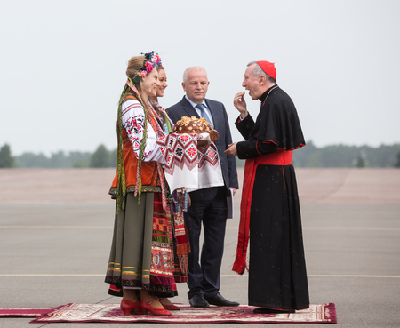 advisers: KIEV, UKRAINE - Jun 15, 2016: First Vice Prime Minister of Ukraine Stepan Kubiv and Secretary of State of the Holy See, Cardinal Pietro Parolin, during a meeting at the airport