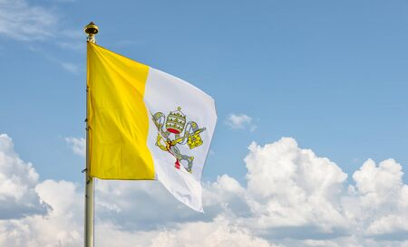 governed: Vatican flag against blue sky. Flag of Vatican City was adopted on June 7, 1929, the year Pope Pius XI signed the Lateran Treaty with Italy, creating a new independent state governed by the Holy See