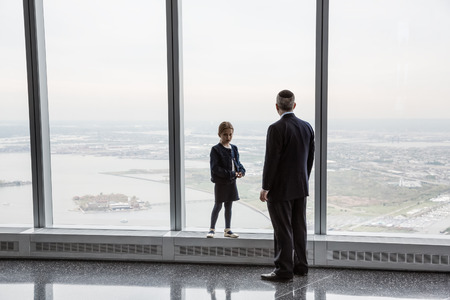 top of the world: NEW YORK, USA - Apr 28, 2016: People in One World Observatory. This observation deck is located at the top of One World Trade Center, the tallest building in New York City.