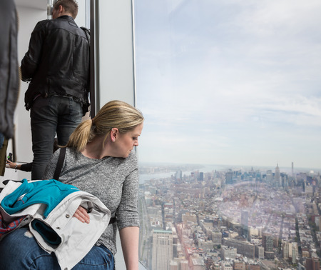 wtc: NEW YORK, USA - Apr 28, 2016: People in One World Observatory. This observation deck is located at the top of One World Trade Center, the tallest building in New York City.