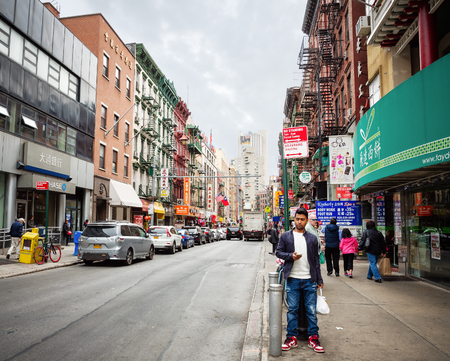 crowds of people: NEW YORK, USA - Apr 28, 2016: Chinatown street scene. The Americans on the streets of Manhattan in NYC