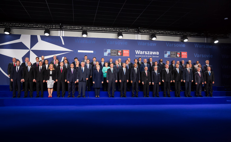 nato summit: WARSAW, POLAND - Jul 8, 2016: NATO summit. Group photo of participants of NATO summit in Warsaw Editorial