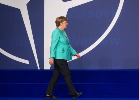 nato: WARSAW, POLAND - Jul 8, 2016: NATO summit.  Chancellor of the Federal Republic of Germany Angela Merkel at the NATO summit in Warsaw Editorial