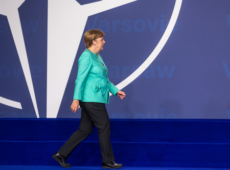 nato summit: WARSAW, POLAND - Jul 8, 2016: NATO summit.  Chancellor of the Federal Republic of Germany Angela Merkel at the NATO summit in Warsaw Editorial