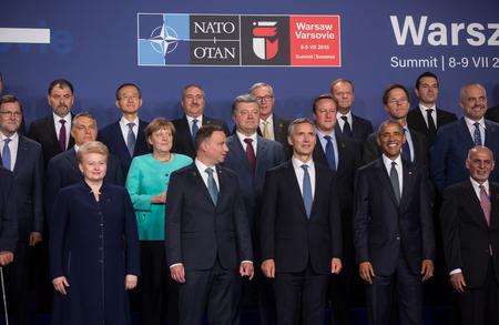 nato: WARSAW, POLAND - Jul 8, 2016: NATO summit. Group photo of participants of NATO summit in Warsaw Editorial