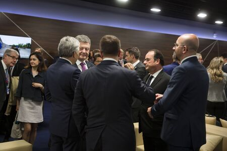 nato summit: WARSAW, POLAND - Jul 9, 2016: NATO summit. President of Ukraine Petro Poroshenko, and French President Francois Hollande at NATO summit