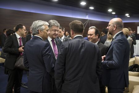 nato: WARSAW, POLAND - Jul 9, 2016: NATO summit. President of Ukraine Petro Poroshenko, and French President Francois Hollande at NATO summit