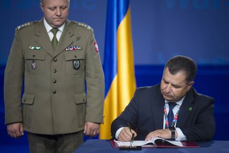 minister of war: WARSAW, POLAND - Jul 9, 2016: NATO summit. Defense Minister of Ukraine Stepan Poltorak during sign a cooperation agreement with the Ministry of National Defence of Poland