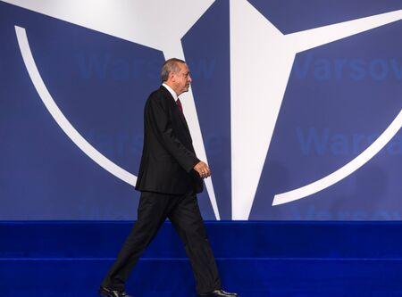 nato summit: WARSAW, POLAND - Jul 9, 2016: NATO summit. Turkish President Recep Tayyip Erdogan at the North Atlantic Treaty Organization summit in Poland Editorial