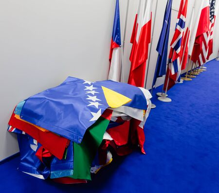 north atlantic treaty organization: WARSAW, POLAND - Jul 9, 2016: Flags of countries participating in the NATO summit in Warsaw, Poland Editorial