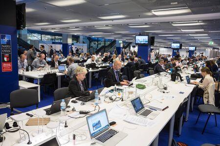 north atlantic treaty organization: WARSAW, POLAND - Jul 9, 2016: North Atlantic Treaty Organization (NATO) summit in Warshaw, Poland. Working moments in the summit press center