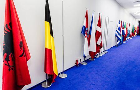 nato summit: WARSAW, POLAND - Jul 9, 2016: Flags of countries participating in the NATO summit in Warsaw, Poland Editorial