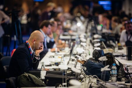treaty: WARSAW, POLAND - Jul 9, 2016: North Atlantic Treaty Organization (NATO) summit in Warshaw, Poland. Working moments in the summit press center