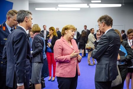 nato: WARSAW, POLAND - Jul 9, 2016: On the sidelines of the NATO summit. German Chancellor Angela Merkel at the North Atlantic Treaty Organization summit in Poland Editorial