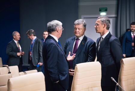 nato summit: WARSAW, POLAND - Jul 9, 2016: Defense Minister of Great Britain Michael Fallon, NATO Secretary General Jens Stoltenberg and President Ukraine Petro Poroshenko at North Atlantic Treaty Organization summit in Poland