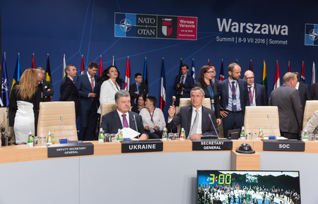 nato: WARSAW, POLAND - Jul 9, 2016: NATO Secretary General Jens Stoltenberg and President Ukraine Petro Poroshenko at North Atlantic Treaty Organization summit in Poland Editorial