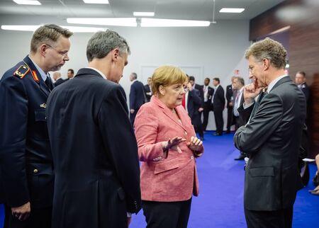 north atlantic treaty organization: WARSAW, POLAND - Jul 9, 2016: On the sidelines of the NATO summit. German Chancellor Angela Merkel at the North Atlantic Treaty Organization summit in Poland Editorial
