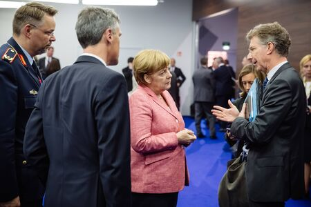 treaty: WARSAW, POLAND - Jul 9, 2016: On the sidelines of the NATO summit. German Chancellor Angela Merkel at the North Atlantic Treaty Organization summit in Poland Editorial
