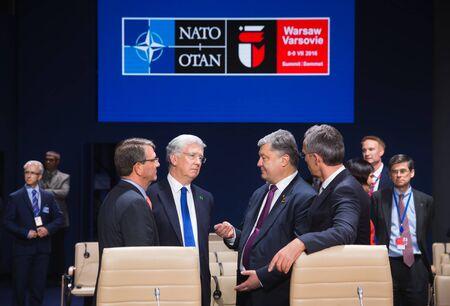nato summit: WARSAW, POLAND - Jul 9, 2016: Defense Minister of Great Britain Michael Fallon, NATO Secretary General Jens Stoltenberg and President Ukraine Petro Poroshenko at NATO summit in Poland