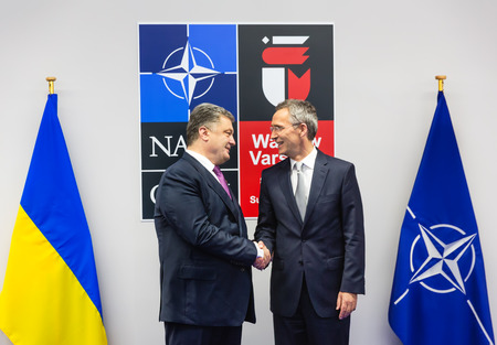 nato summit: WARSAW, POLAND - Jul 9, 2016: NATO Secretary General Jens Stoltenberg and President Ukraine Petro Poroshenko at North Atlantic Treaty Organization summit in Poland Editorial