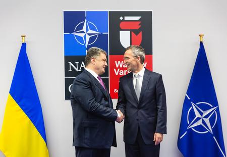 WARSAW, POLAND - Jul 9, 2016: NATO Secretary General Jens Stoltenberg and President Ukraine Petro Poroshenko at North Atlantic Treaty Organization summit in Poland Editorial