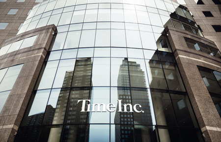 publishes: NEW YORK, USA - Apr 28, 2016: Time Inc. is an American New York-based publishing company. It owns and publishes over 90 magazines brands, most notably its namesake, Time