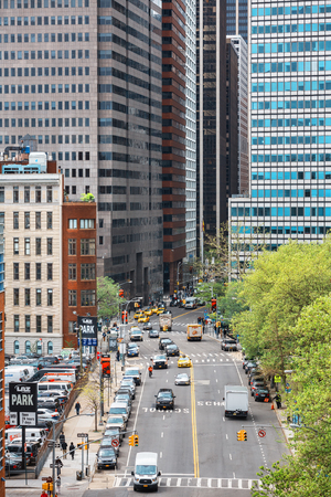 NEW YORK, USA - Apr 29, 2016: Streets of Manhattan, New York City. Manhattan is the most densely populated of the five boroughs of New York City