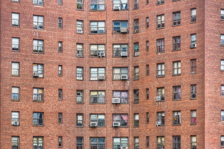 brick facades: NEW YORK, USA - Apr 29, 2016: Brick facades of the buildings in Manhattan, New York City. Manhattan is the most densely populated of the five boroughs of New York City